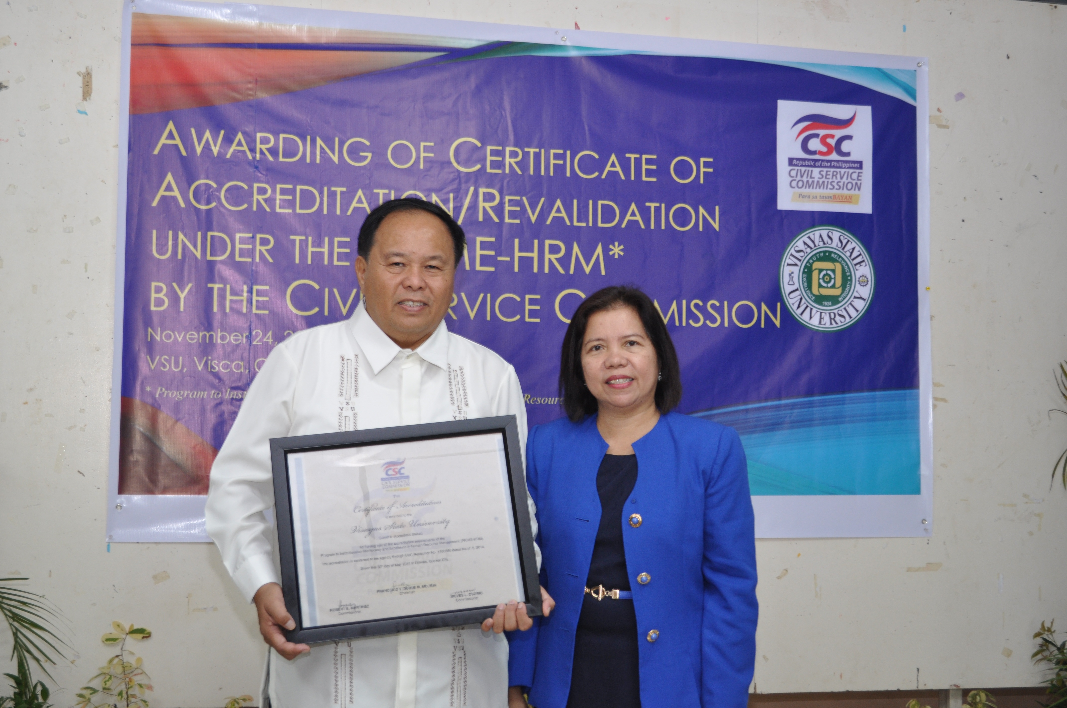 Dr.-Jose-L.-Bacusmo-and-Dir.-Pharida-Q.-Aurelia-posing-during-the-awarding-of-Certificate-of-Accreditation-to-VSU.